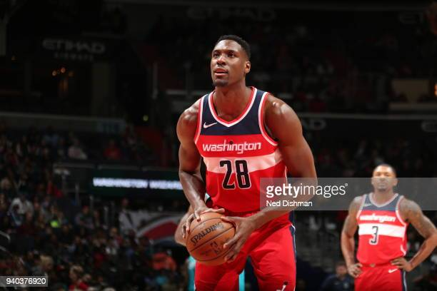 Ian Mahinmi of the Washington Wizards shoots a free throw during the game against the Charlotte Hornets on March 31 2018 at the Capital One Arena in...