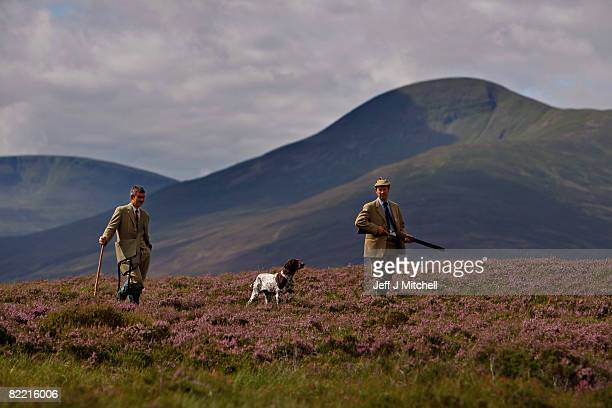 Ian McColl director of the Game and Conservation Trust and gamekeeper Alastaitr Lyon watch for grouse on the Railia and Milton Estate on Drumochter...