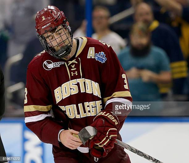 Ian McCoshen of the Boston College Eagles reacts to the loss to Quinnipiac Bobcats during semifinals of the 2016 NCAA Division I Men's Hockey...