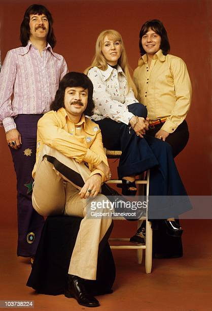 Ian McCredie Ken Andrew Sally Carr and Eric McCredie of Middle Of The Road pose for a studio group portrait in 1972 in Amsterdam Netherlands