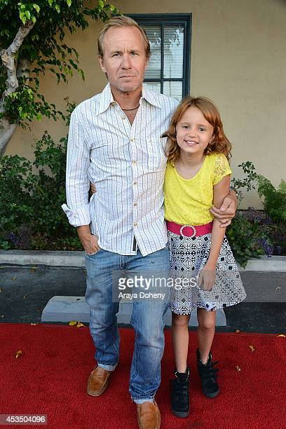 Ian McCrudden and Maggie Elizabeth Jones arrive at the screening of Child Of Grace Arrivals at Raleigh Studios on August 11 2014 in Los Angeles...
