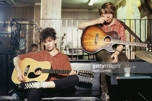 Ian McCulloch and Will Sargeant of postpunk group Echo And The Bunnymen perfom seated circa 1984