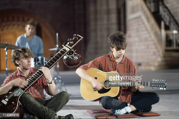 Ian McCulloch Will Sargeant and Pete De Freitas of British band Echo And The Bunnymen perform seated circa 1985
