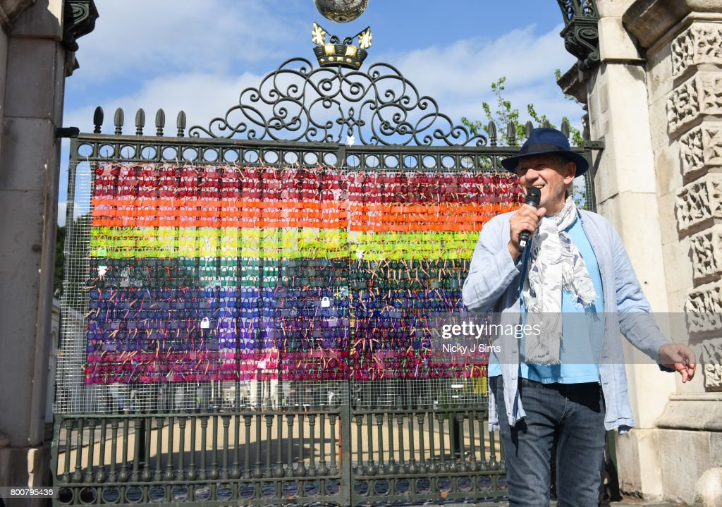Ian McKellen unveils a rainbow coloured love locks display on West gates at the Old Royal Naval College on June 25, 2017 in Greenwich, England.The Love Locks display will be created throughout the day. Members of the public can come and write a message on the back of a colourful love lock and then tie it to the gate, creating a beautiful, stained-glass effect rainbow.