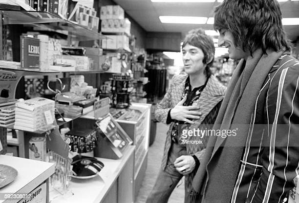 Ian McLagan and Ronnie Wood looking around a shop in the States April 1975