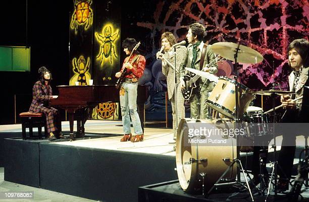 Ian McLagan Ronnie Wood Rod Stewart Ronnie Lane and Kenney Jones of the Faces perform on the BBC television show 'Top of the Pops' in February 1973