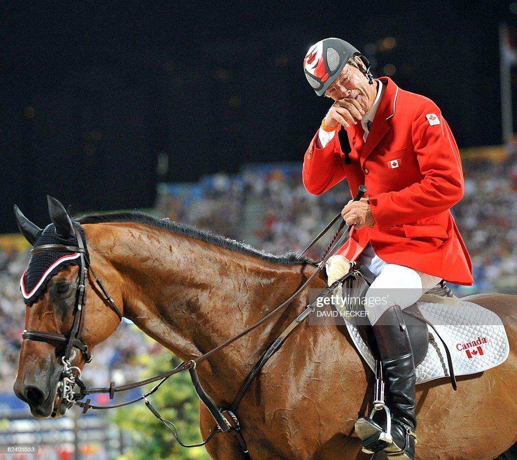 Ian Millar of Canada reacts after riding : News Photo