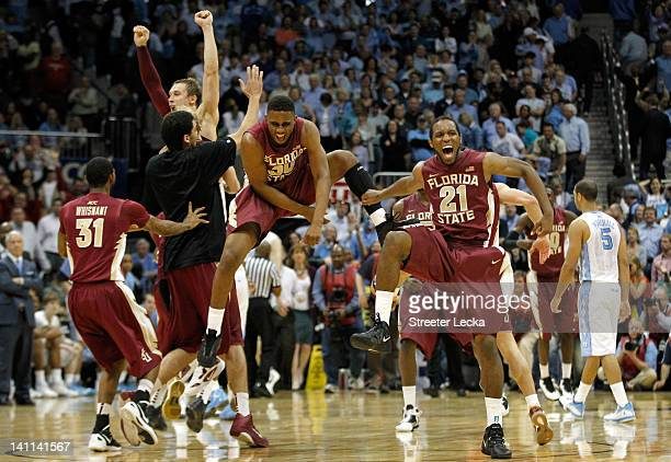 Ian Miller and Michael Snaer of the Florida State Seminoles celebrate after they won 8582 against the North Carolina Tar Heels uring the Final Game...