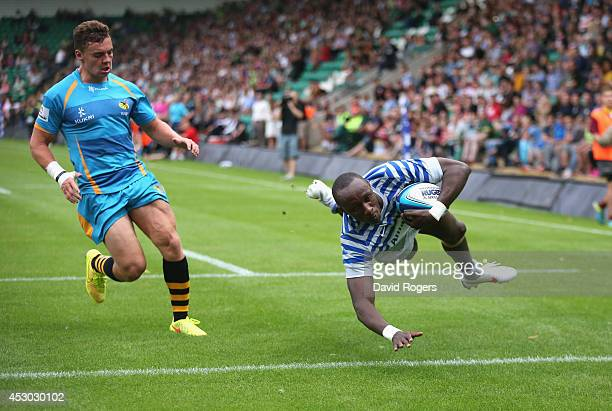 Ian Minjire of Saracens dives over for a try against Wasps during the Premiership Rugby 7's Series at Franklin's Gardens on August 1 2014 in...
