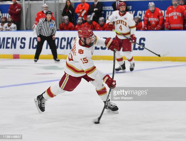 Ian Mitchell of the Denver Pioneers shoots against the Ohio State Buckeyes during an NCAA Division I Men's Ice Hockey West Regional Championship...