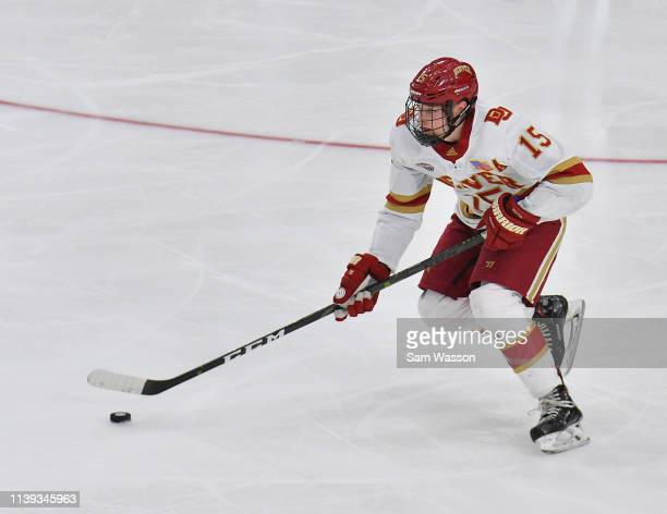 Ian Mitchell of the Denver Pioneers skates with the puck during his team's NCAA Division I Men's Ice Hockey West Regional Championship Semifinal game...