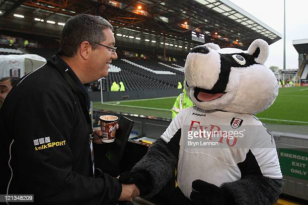 Ian 'Moose' Abrahams from Talksport Radio shakes hands with the Fulham mascot ahead of the UEFA Europa League PlayOff round qualifying first leg...
