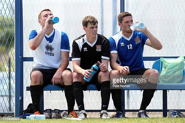 Ian Morris of Northampton Town looks on as teammates Lee Collins and Ben Tozer take a drink during a training session during PreSeason Training on...