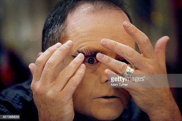 Ian Mowat attaches his pink sparkly eyelashes beneath his eyelid as he becomes the character of Dame Trott in Jack and The Beanstalk at the Connaught...
