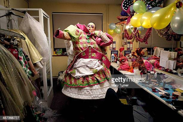 Ian Mowat changes into his dress as he becomes the character of Dame Trott in Jack and The Beanstalk at the Connaught Theatre on December 11 2013 in...