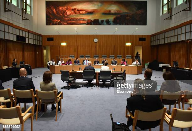 Ian Narev chief executive officer of Commonwealth Bank of Australia left and Catherine Livingstone chairman right appear before the House of...