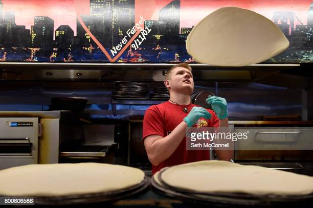 Ian Newell tosses dough in the air at Big Bill's Pizza on June 20 in Centennial Colorado