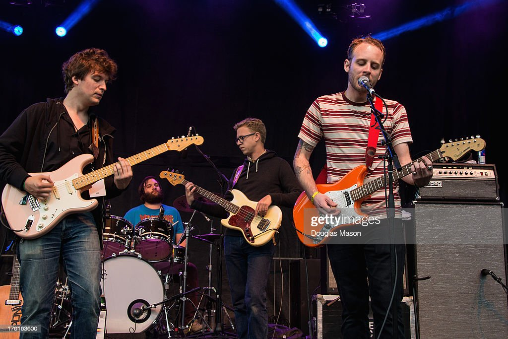 Ian O'Neil (guitar), Dennis Ryan (drums), Christopher Ryan (bass), and John McCauley (guitar - vocals) of Deer Tick performs during the 9th Annual Mountain Jam at Hunter Mountain on June 7, 2013 in Hunter, New York.