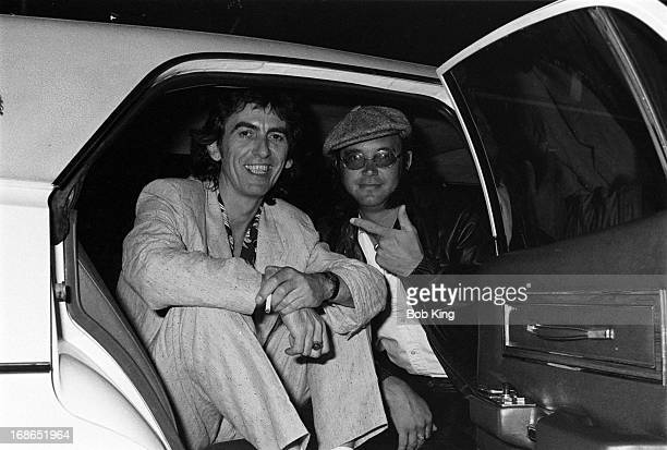 Ian Paice of Deep Purple in a limousine with George Harrison after a concert on Deep Purple's Perfect Strangers World Tour at the Entertainment...
