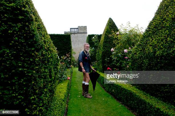Ian Pollard stands halfnaked on a chilly day in the Abbey House Gardens on Clothes Optional Day in Malmesbury England Sept 23 2012 During the summer...