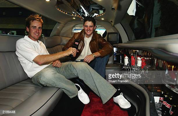 Ian Poulter and Justin Rose of England share a drink in the back of a stretch limousine as Justin goes to his sisters birthday party after the third...