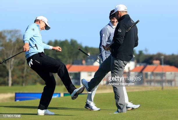 Ian Poulter and Lee Westwood of England foot tap on the 18th green after their second round of the Aberdeen Standard Investments Scottish Open at The...