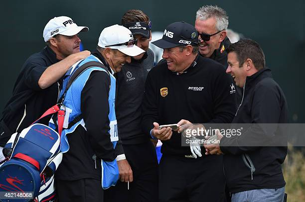 Ian Poulter and Lee Westwood of England share a joke with caddies and friends during a practice round prior to the start of the 143rd Open...