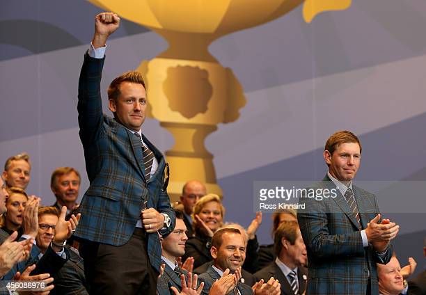 Ian Poulter and Stephen Gallacher of Europe are announced as playing partners for their opening fourball match during the Opening Ceremony ahead of...