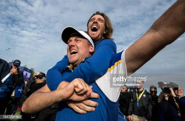 Ian Poulter and Tommy Fleetwood celebrate victory after the singles matches of the 2018 Ryder Cup at Le Golf National on September 30 2018 in Paris...