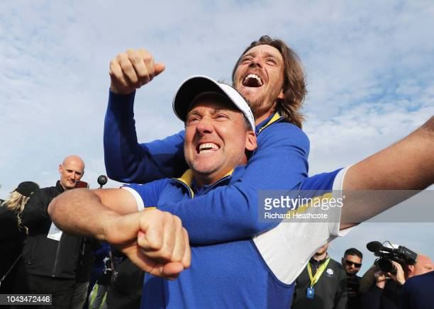 Ian Poulter and Tommy Fleetwood of Europe celebrate winning the Ryder Cup during singles matches of the 2018 Ryder Cup at Le Golf National on...