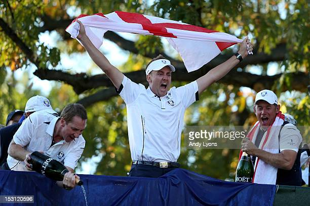 Ian Poulter John McLaren and Lee Westwood of Europe celebrate after Europe defeated the USA 145 to 135 to retain the Ryder Cup during the Singles...