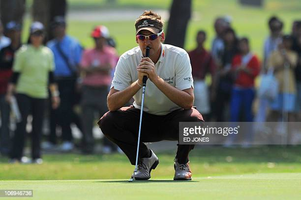 Ian Poulter of Britain contemplates a putt as he competes in the UBS European Tour Hong Kong open at the Hong Kong golf club on November 18 2010 The...