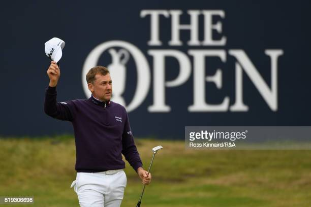 Ian Poulter of England acknowledges the applause on the 18th hole after completing a 67 during the first round of the 146th Open Championship at...