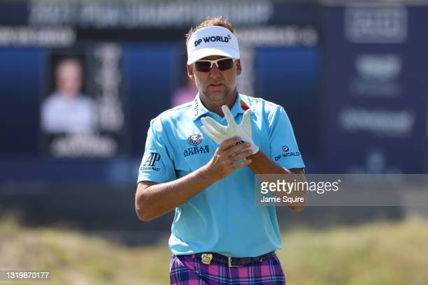 Ian Poulter of England adjusts his glove on the 16th hole during the final round of the 2021 PGA Championship held at the Ocean Course of Kiawah...