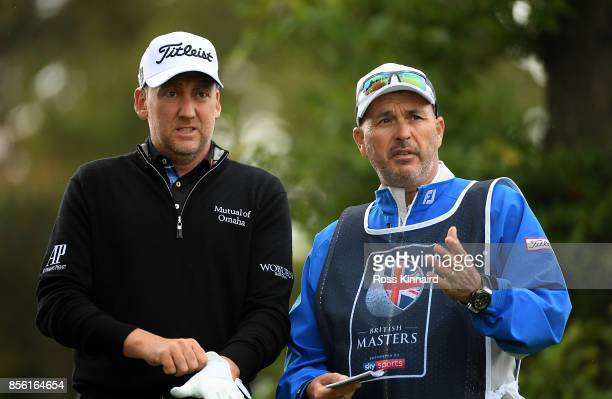 Ian Poulter of England and his caddie look on on the 1st tee during day four of the British Masters at Close House Golf Club on October 1 2017 in...
