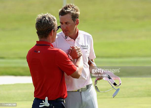 Ian Poulter of England and Luke Donald of England after the final of the Volvo World Match Play Championship at Finca Cortesin on May 22 2011 in...