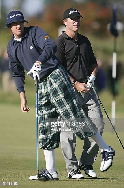 Ian Poulter of England and Peter Lonard of Australia look on during the second round of the Dunhill Links Championship at the Old Course on October 7...