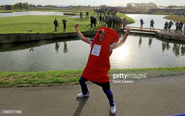 Ian Poulter of England and the European Team celebrates in a fan's British Postbox outfit after Europe's 175105 win over the United States during the...