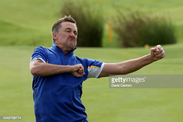 Ian Poulter of England and the European Team celebrates on the 18th green after his win against Dustin Johnson by 2 holes in Europe's 175105 win over...