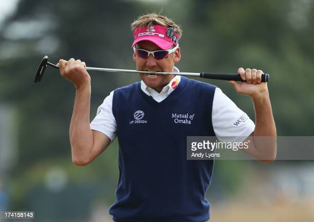 Ian Poulter of England bites his putter after missing a birdie putt on the 1st green during the final round of the 142nd Open Championship at...