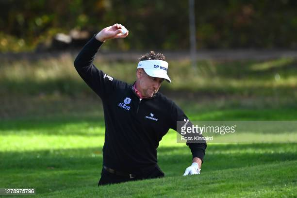Ian Poulter of England bounces a ball off a bunker during a practice round ahead of the BMW PGA Championship at Wentworth Golf Club on October 07,...