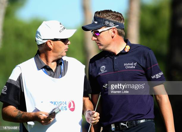Ian Poulter of England cats to his caddie during the final round of the 2013 Turkish Airlines Open on the Montgomerie Maxx Royal Course on November...