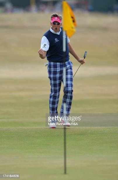 Ian Poulter of England celebrates a birdie putt on the 10th hole during the final round of the 142nd Open Championship at Muirfield on July 21 2013...