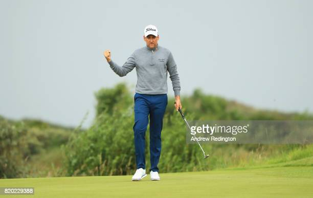 Ian Poulter of England celebrates after a birdie on the 12th hole during the second round of the 146th Open Championship at Royal Birkdale on July 21...