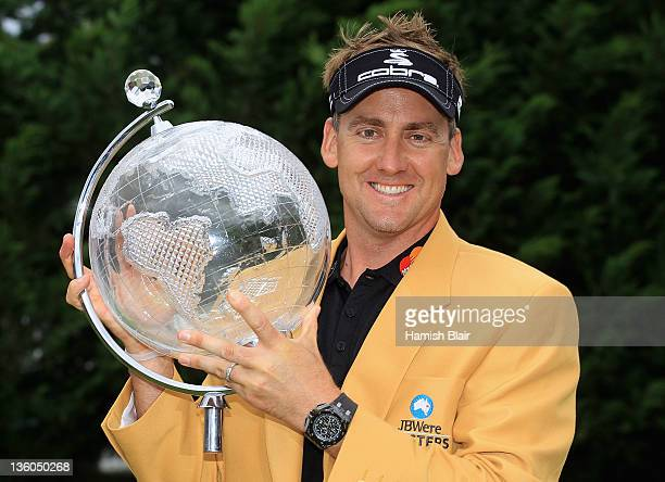 Ian Poulter of England celebrates his victory with the trophy and gold jacket after day four of the 2011 Australian Masters at The Victoria Golf Club...