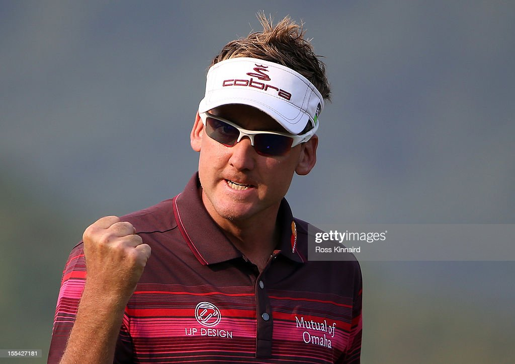 Ian Poulter of England celebrates on the 18th green after winning the WGC HSBC Champions during the final round at the Mission Hills Resort on November 4, 2012 in Shenzhen, China.