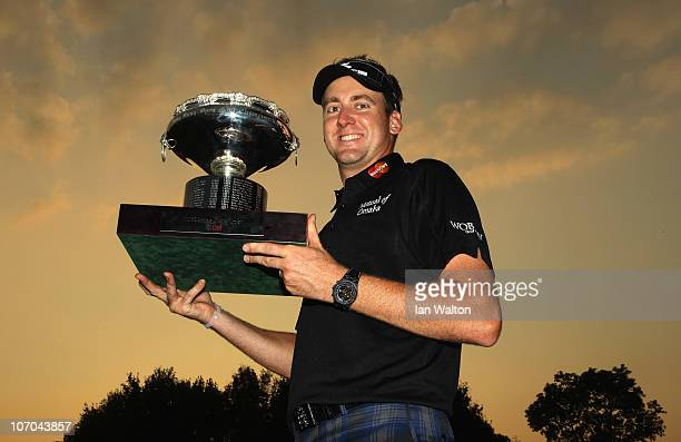 Ian Poulter of England celebrates with the trophy after winning the UBS Hong Kong Open at The Hong Kong Golf Club on November 21, 2010 in Hong Kong,...