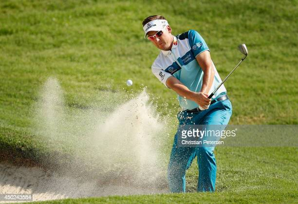 Ian Poulter of England chips from the bunker onto the fourth green during the third round of the FedEx St. Jude Classic at the TPC Southwind on June...