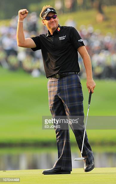 Ian Poulter of England gestures on the 18th green after winning the UBS Hong Kong Open golf tournament at the Hong Kong Golf Club on November 21 2010...