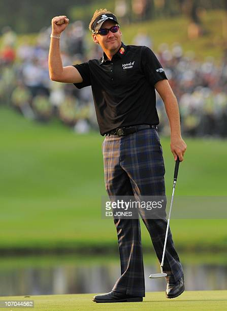 Ian Poulter of England gestures on the 18th green after winning UBS Hong Kong Open golf tournament at the Hong Kong Golf Club on November 21 2010...